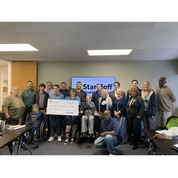 Imagine of Susan Menhard and the Fall 2019 Capstone Course being presented with a check.